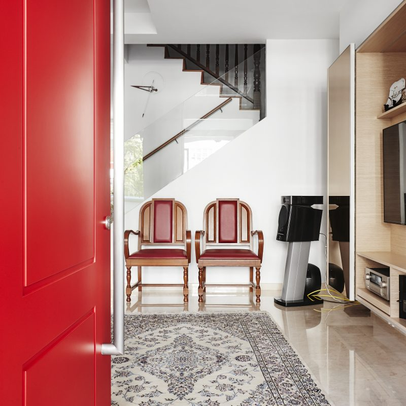red door colour entrance way house home wooden chair